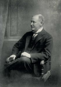 A black and white image of Rothschild sitting down